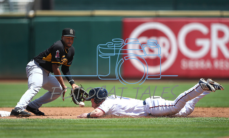 Reno Aces' Zach Borenstein gets hit in the nose on a pick-off play at second base against Salt Lake Bees' Sherman Johnson at Greater Nevada Field in Reno, Nev., on Tuesday, June 7, 2016. <br />