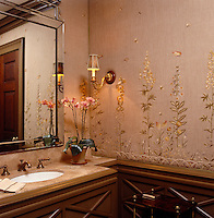 Bringing a touch of the garden into the house; in this bathroom summer flowers are embroidered on stunning silk wallpaper