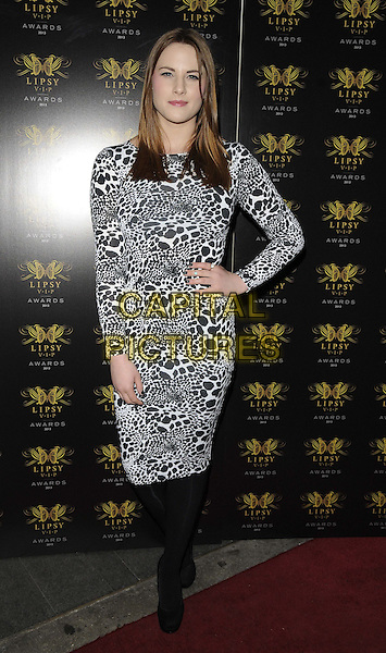 Lucy Watson<br /> The Lipsy VIP Fashion Awards 2013, DSTRKT, Rupert St., London, England.<br /> May 29th, 2013<br /> full length white black leopard print dress hand on hip tights<br /> CAP/CAN<br /> &copy;Can Nguyen/Capital Pictures