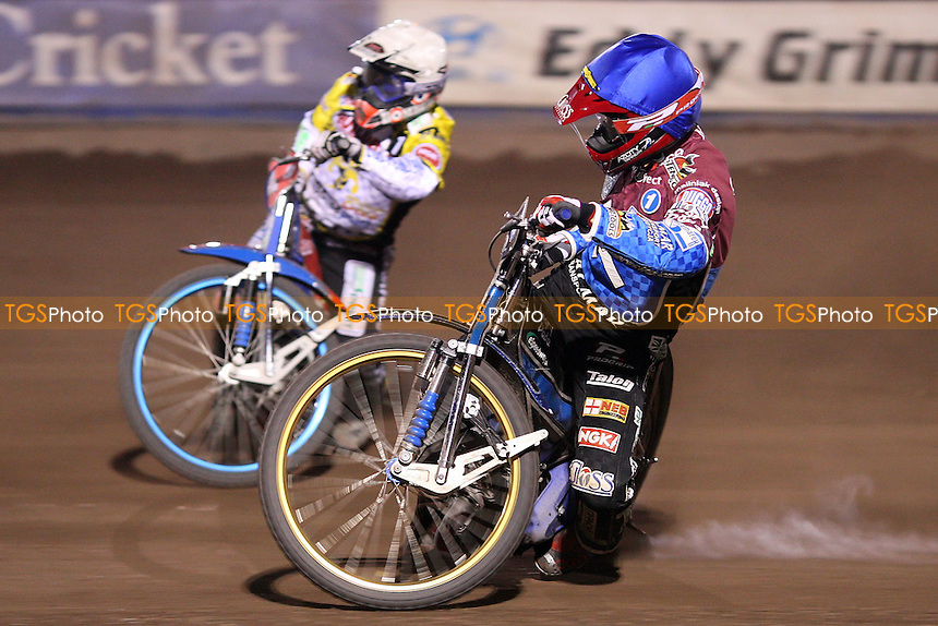 Heat 15: Krzysztof Kasprzak (blue) and Chris Harris (white) - Lakeside Hammers vs Coventry Bees, Elite League Speedway at the Arena Essex Raceway, Purfleet - 09/04/10 - MANDATORY CREDIT: Rob Newell/TGSPHOTO - Self billing applies where appropriate - 0845 094 6026 - contact@tgsphoto.co.uk - NO UNPAID USE.