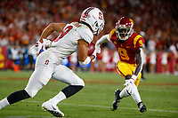 LOS ANGELES, CA - SEPTEMBER 8: Stanford Cardinal wide receiver Osiris St. Brown #9 is pursued by USC Trojans cornerback Greg Johnson #9 after a pass reception during a game between USC and Stanford Football at Los Angeles Memorial Coliseum on September 7, 2019 in Los Angeles, California.