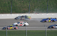 Sept. 27, 2008; Kansas City, KS, USA; NASCAR Nationwide Series driver Mark Martin (5) crashes during the Kansas Lottery 300 at Kansas Speedway. Mandatory Credit: Mark J. Rebilas-