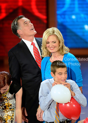 Mitt Romney, Republican nominee for President of the United States, looks up at the balloons as his wife, Ann, looks at a family member at the 2012 Republican National Convention in Tampa Bay, Florida on Thursday, August 30, 2012.  .Credit: Ron Sachs / CNP.(RESTRICTION: NO New York or New Jersey Newspapers or newspapers within a 75 mile radius of New York City)