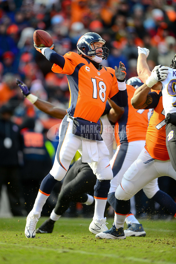 Jan 12, 2013; Denver, CO, USA; Denver Broncos quarterback Peyton Manning (18) throws a pass in the first quarter against the Baltimore Ravens during the AFC divisional round playoff game at Sports Authority Field.  Mandatory Credit: Mark J. Rebilas-