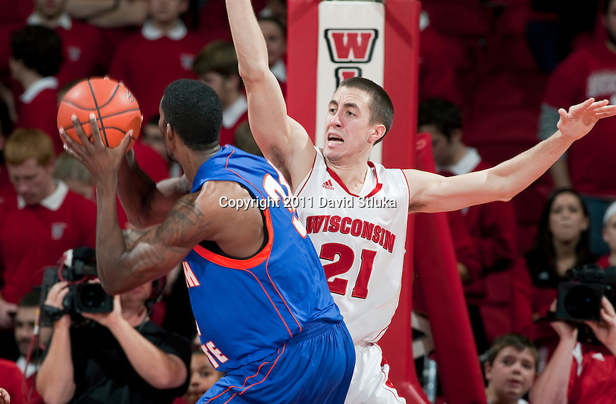Wisconsin Badgers guard Josh Gasser (21) plays defense during an NCAA college basketball game against the Savannah State Tigers on December 15, 2011 in Madison, Wisconsin. The Badgers won 66-33. (Photo by David Stluka)