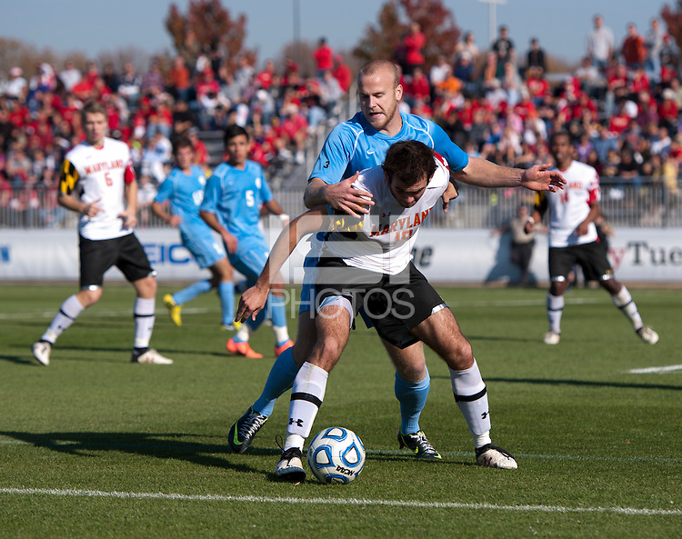Dakota Edwards (18) of Maryland fights for the ball with Josh Rice (7) of North Carolina during the game at the Maryland SoccerPlex in Germantown, MD. Maryland defeated North Carolina, 2-1,  to win the ACC men's soccer tournament.