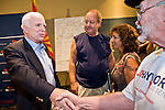 """July 10, 2010 - PHOENIX, AZ: US Senator JOHN MCCAIN (R-AZ) shakes hands with a supporter of his opponent, JD Hayworth, after a town hall meeting in Phoenix. Sen. McCain held a """"town hall"""" meeting at a hotel in Phoenix Saturday morning. He criticized the Obama administration's handling of the war in Afghanistan, specifically the July 2011 date for the beginning of the withdrawl of US forces, the administration's handling of the immigration and border security issue and the recently passed health care reform bill, which he called """"Obamacare."""" McCain is in a primary battle with former Congressman JD Hayworth, he did not mention Hayworth, by name during the meeting.   Photo by Jack Kurtz"""
