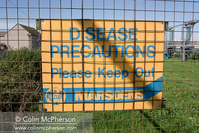 A warning sign at the entrance to a field of raised cage laying units for breeding and maturing partridges at Hy-Fly Hatcheries, a company based in Preesall, near Blackpool, Lancashire which specialises in breeding partridge and pheasant to be sold to sporting estates. The partridges are kept in small cages for up to three years while they mature before being sold. Pheasants are also kept in cages but are transferred to outdoor pens as they mature. The company, which is owned by Ray Holden, produces around three million day-old chicks per year.