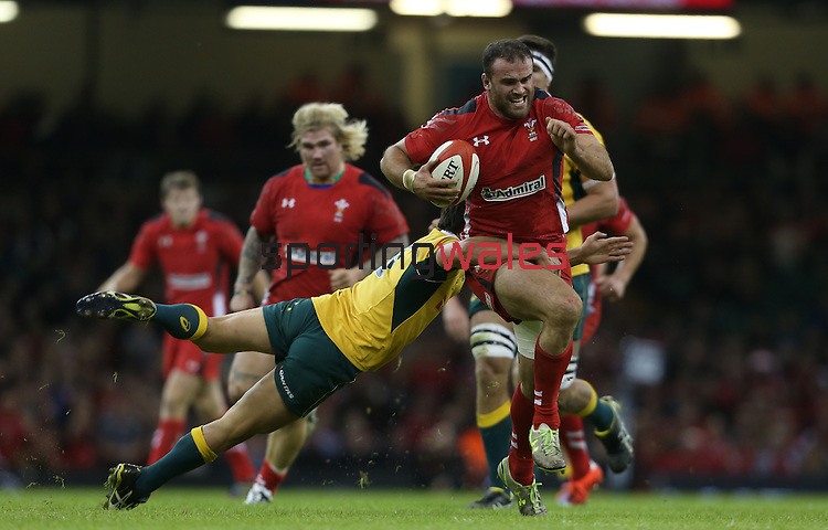 Australian scrum half Nick Phipps tackles Wales centre Jamie Roberts.<br /> Dove Men Series 2014<br /> Wales v Australia<br /> Millennium Stadium<br /> 08.11.14<br /> ©Steve Pope-SPORTINGWALES