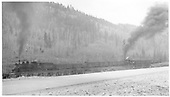 K-27 #452 with #461 mid-train working frieght train near Placerville, CO.<br /> RGS  Placerville, CO  Taken by Hanft, Robert M. - 5/11/1951