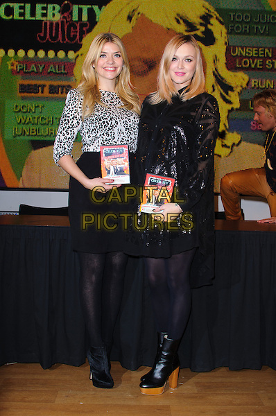 Holly Willoughby & Fearne Cotton.The stars meet fans and sign copies of the new 'Celebrity Juice: Too Juicy For TV 2' DVD at HMV, Oxford Street..London, England, UK, .22nd November 2012.full length black skirt dress tights ankle boots sequined sequin pregnant maternity leopard print top animal .CAP/CJ.©Chris Joseph/Capital Pictures.