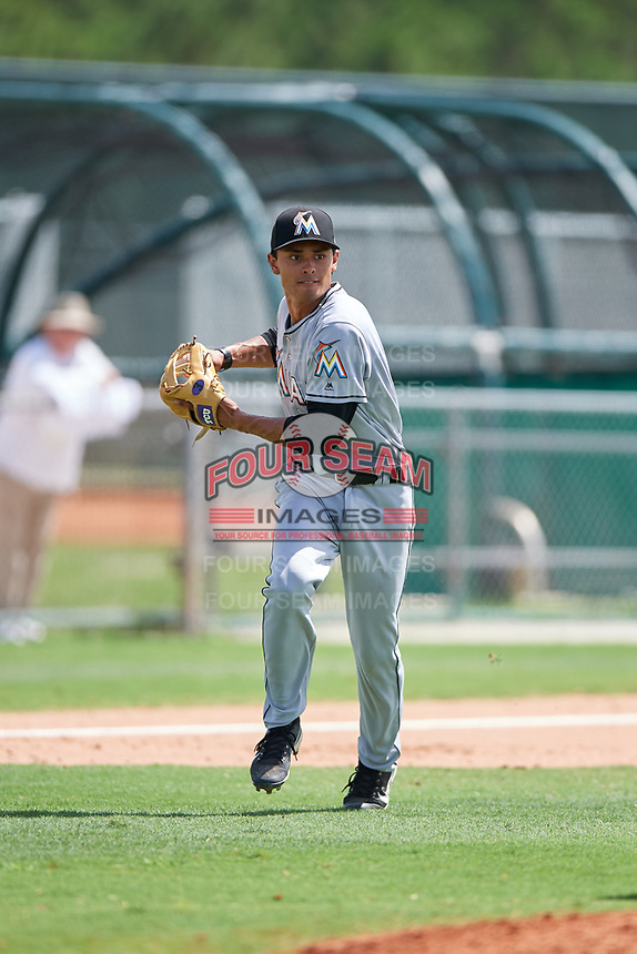 GCL Marlins third baseman Elliott Barzilli (12) during the first game of a doubleheader against the GCL Nationals on July 23, 2017 at Roger Dean Stadium Complex in Jupiter, Florida.  GCL Nationals defeated the GCL Marlins 4-0.  (Mike Janes/Four Seam Images)