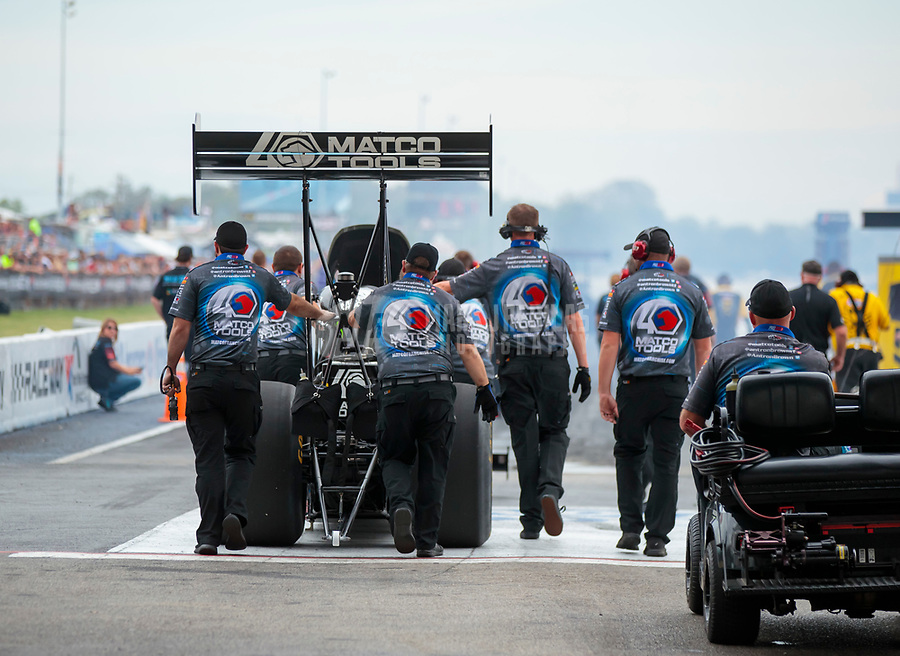 Sep 28, 2019; Madison, IL, USA; Crew members push the dragster of NHRA top fuel driver Antron Brown during qualifying for the Midwest Nationals at World Wide Technology Raceway. Mandatory Credit: Mark J. Rebilas-USA TODAY Sports