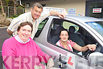 TEST: Catherine Goggins (right) who passed her driving test in a special adapted car, with Terry O'Brien of the Irish Wheelchair Association and Paudie McKenna (Driving Instructor).
