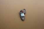 Two boats are anchored in a river in Quang Nam province, central Vietnam. Jan. 14, 2013.