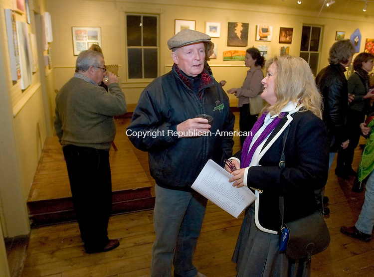 KENT, CT- 22 NOVEMBER 2008 --112208JS06- Clemence Gregory. left, talks with Maureen Berescik, the arts coordinator with Bethel Public Schools, during the opening of a collection titled 'A memorial for Jacques with 100 artists' held at the Bachelier Cardonsky Gallery in Kent. The show is to celebrate the life of the late Jacques Kaplan, owner of the Bachelier Cardonsky Gallery before his death last summer. The show continues through December 21, 2008.                                                                                                                            <br /> Jim Shannon / Republican-American