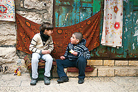 Two boys enjoy a conversation in the Christian Quarter of the Old City of Jerusalem. The Christian Quarter was built around the Church of the Holy Sepulchre and contains few houses. Most of the residents of the quarter are concentrated near Jericho Gate in the southern-eastern part of the quarter.