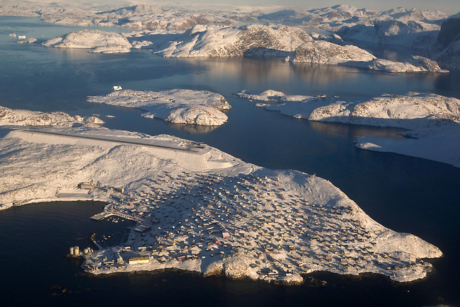 Aerial view of the town of Upernavik with the airport runway behind. West Greenland