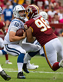 Indianapolis Colts quarterback Andrew Luck (12) is sacked by Washington Redskins defensive tackle Matthew Ioannidis (98) in the second quarter at FedEx Field in Landover, Maryland on Sunday, September 16, 2018.<br /> Credit: Ron Sachs / CNP