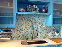 This custom kitchen features a handmade Climbing Vine backsplash shown in Quartz and Aquamarine jewel glass from the Silk Road Collection by Sara Baldwin for New Ravenna.<br />
