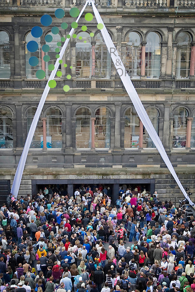 Street performers, abseilers and an animatronic dinosaur along with a seven thousand crown mark the reopening of the National Museum of Scotland after a 3 year modernisation, Edinburgh, Scotland, 29th July 2011..Picture:Scott Taylor Universal News And Sport (Europe) .All pictures must be credited to www.universalnewsandsport.com. (Office)0844 884 51 22.