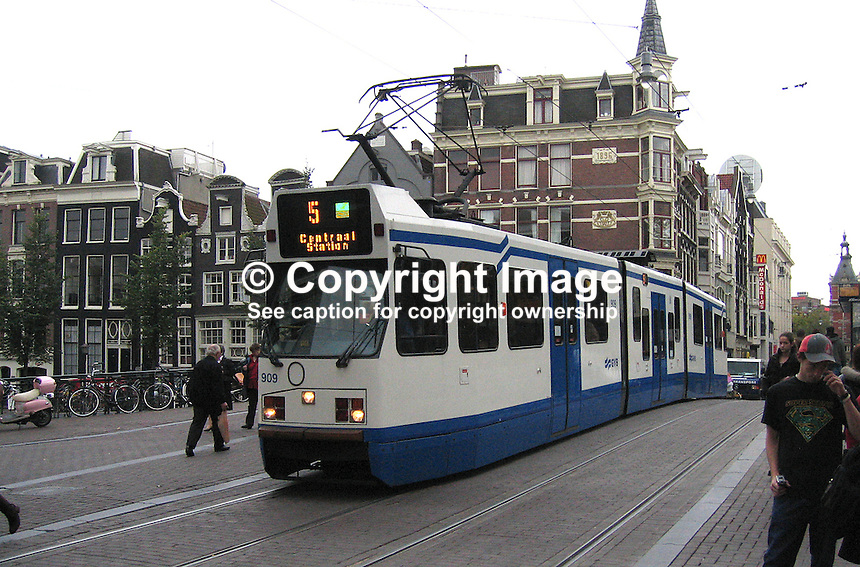 Amsterdam, Holland, Netherlands, street, pedestrians, tram, 200710050083...Copyright Image from Victor Patterson, 54 Dorchester Park, Belfast, UK, BT9 6RJ..Tel: +44 28 9066 1296.Mob: +44 7802 353836.Voicemail +44 20 8816 7153.Skype: victorpattersonbelfast.Email: victorpatterson@mac.com.Email: victorpatterson@ireland.com (back-up)..IMPORTANT: If you wish to use this image or any other of my images please go to www.victorpatterson.com and click on the Terms & Conditions. Then contact me by email or phone with the reference number(s) of the image(s) concerned.