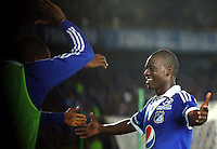 BOGOTÁ -COLOMBIA, 18-05-2013. Erick Moreno de Millonarios celebra un gol en contra del Junior durante partido de la fecha 16 de la Liga Postobón 2013-1 jugado en el estadio El Campín en Bogotá./ Erick Moreno  of Millonarios celebrates a goal against Junior with Erick Moreno (R) during match of the 16th date of Postobon  League 2013-1 at El Campin stadium in Bogotaa. Photo: VizzorImage/STR