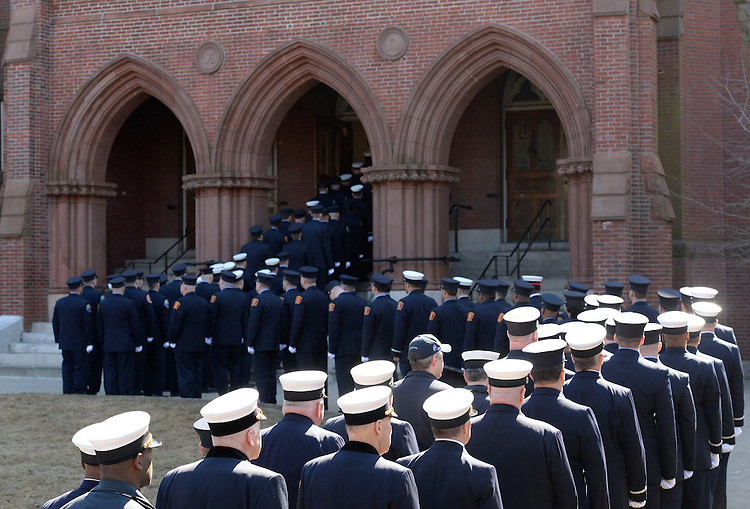 Firefighter file into Church of St. Patrick in Watertown during a wake for Boston firefighter Lt. Edward Walsh, Jr. on Tuesday, April 01, 2014. Photo by Christopher Evans