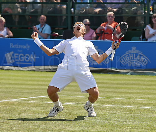 27.06.2015.  Nottingham, England. Aegon Nottingham Open Tennis Tournament. The moment Denis Istomin (UZB) won his first ATP title against Sam Querrey (USA) by two sets to love on Centre Court