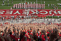 "Ohio State football players and the Block O student section warm up with the ""quick cals"" drill prior to the NCAA football game against Buffalo at Ohio Stadium on Aug. 31, 2013. (Adam Cairns / The Columbus Dispatch)"