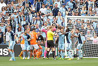 Referee Drew Fischer initially gave a penalty to Houston Dynamo, after consulting his AR1 he reversed the decision..Sporting Kansas City and Houston Dynamo played to a 1-1 tie at Sporting Park, Kansas City, Kansas.