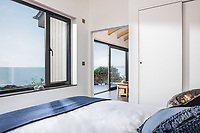 BNPS.co.uk (01202 558833)<br /> Pic: UniqueHomeStays/BNPS<br /> <br /> Pictured: There is a double bedroom, bathroom with walk-in shower, modern kitchen, a utility area and living area with large sliding doors that make the most of the 180 degree views.<br /> <br /> A couple who spent £450,000 on turning a 'rotting shed' into an exclusive seaside bolthole hope to recoup their money - by renting it out for £3,150 a week. <br /> <br /> Tracey Gilpin and Peter Burridge went out on a limb when they bought the 60-year-old wooden shack for a whopping £220,000.<br /> <br /> Despite its ramshackle condition, the cabin could command such a hefty asking price as it is located halfway up a cliff with stunning views of Whitsand Bay in Cornwall.<br /> <br /> But in order to make the coastal chalet a viable holiday let the couple had to demolish it and build a new one from scratch.