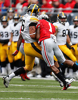 Ohio State Buckeyes cornerback Bradley Roby (1) makes helmet to helmet contact with Iowa Hawkeyes tight end C.J. Fiedorowicz (86) in the first quarter of the NCAA football game between the Ohio State Buckeyes and the Iowa Hawkeyes at Ohio Stadium in Columbus, Saturday afternoon, October 19, 2013. The Ohio State Buckeyes defeated the Iowa Hawkeyes 34 - 24. (The Columbus Dispatch / Eamon Queeney)