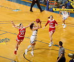 BROOKINGS, SD - FEBRUARY 22: Rylie Cascio Jensen #2 of the South Dakota State Jackrabbits lays the ball up past Madison McKeever #23 of the South Dakota Coyotes Saturday at Frost Arena in Brookings, SD. (Photo by Dave Eggen/Inertia)