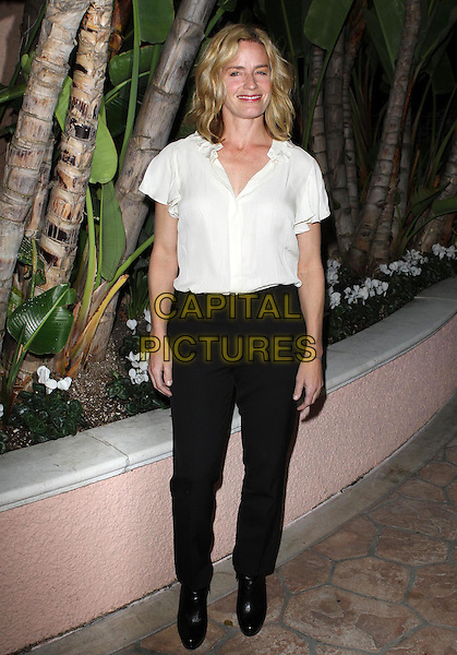 Elisabeth Shue.The Children's Defense Fund's 21st Annual Beat The Odds Awards held at The Beverly Hills Hotel, Beverly Hills, California, USA..December 1st, 2011 .full length black trousers white top blouse .CAP/ADM/KB.©Kevan Brooks/AdMedia/Capital Pictures.