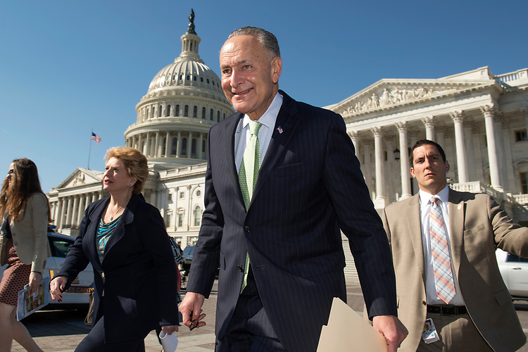 UNITED STATES - MARCH 9: Senate Minority Leader Charles Schumer, D-N.Y., and Sen. Debbie Stabenow, D-Mich., make their way to a news conference in the Senate swamp to defend the Affordable Care Act, March 9, 2017. The event featured people who spoke about how the law helped deliver them medical coverage. (Photo By Tom Williams/CQ Roll Call)