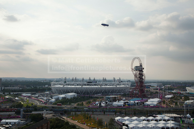 12/08/2012. LONDON, UK. The Olympic Stadium, ArcelorMittal Orbit and Goodyear Blimp are seen ahead of the the closing ceremony of the 2012 Summer Olympics in London today (12/08/12). The Games of the 30th Olympiad today come to a close in London after two weeks of athletics and sports competition carried out by 204 countries from around the world. Photo credit: Matt Cetti-Roberts