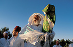 Samaria, Samaritan pilgrimage To Mount Gerizim done on Passover, Shavuot and Succot holidays, the priest with the Torah scrolls<br />