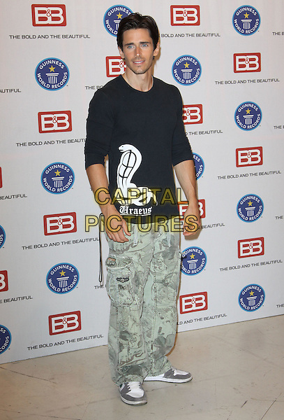 "BRANDON BEEMER .Guinness World Record's Official Validation For ""The Bold & The Beautiful"" held At CBS Studios, Los Angeles, California, USA..May 18th, 2010.full length green camouflage trousers black top .CAP/ADM/KB.©Kevan Brooks/AdMedia/Capital Pictures."
