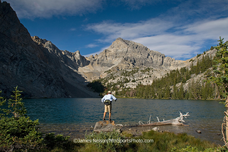 An angler casts a fly for trout on an alpine lake in the Lost River Range of Idaho.