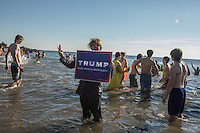 BROOKlLYN, NY - JANUARY 01 : A man holds a Trump sign during the annual Coney Island Polar Bear Club New Year's Day swim by running into the ocean at Coney Island , Brooklyn on January 01, 2017. Photo by VIEWpress/Maite H. Mateo.