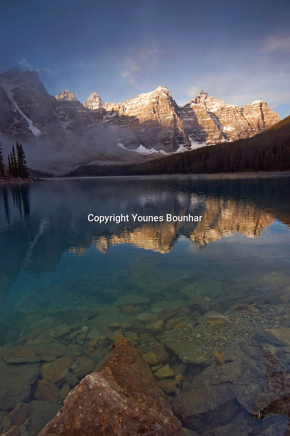 Reflection of the Ten Peaks in Turquoise Waters of beautiful Moraine Lake in the early morning