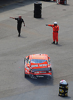 Jun 1, 2008; Dover, DE, USA; NASCAR Sprint Cup Series driver Tony Stewart is directed into his garage stall after crashing during the Best Buy 400 at the Dover International Speedway. Mandatory Credit: Mark J. Rebilas-US PRESSWIRE