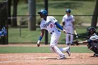 AZL Dodgers left fielder Frank Sanchez (8) follows through on his swing in front of catcher Luis Roman (4) during an Arizona League game against the AZL Padres 2 at Camelback Ranch on July 4, 2018 in Glendale, Arizona. The AZL Dodgers defeated the AZL Padres 2 9-8. (Zachary Lucy/Four Seam Images)