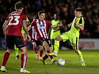 Bolton Wanderers' Dennis Politic (right) competing with Lincoln City's Conor Coventry <br /> <br /> Photographer Andrew Kearns/CameraSport<br /> <br /> The EFL Sky Bet League One - Lincoln City v Bolton Wanderers - Tuesday 14th January 2020  - LNER Stadium - Lincoln<br /> <br /> World Copyright © 2020 CameraSport. All rights reserved. 43 Linden Ave. Countesthorpe. Leicester. England. LE8 5PG - Tel: +44 (0) 116 277 4147 - admin@camerasport.com - www.camerasport.com
