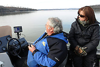 NWA Democrat-Gazette/FLIP PUTTHOFF <br /> Kevin and Denise Rivers watch their depth-finder for schools of shad on Jan. 16, 2016 while striper fishing at Beaver Lake. Stripers follow the shad schools and feed on the bait fish.