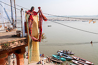 A lady dries up her clothes at her house in Varanasi, Uttar Pradesh, India.