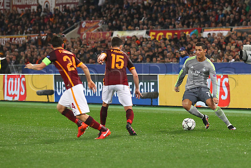 17.02.2016. Stadio Olimpico, Rome, Italy. UEFA Champions League, Round of 16 - first leg, AS Roma versus Real Madrid. CRISTIANO RONALDO is stopped by Pjanic and Florenzi (Roma)