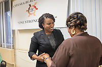Ayanna Pressley (left) greets people after speaking at an event put on by Chelsea Black Community at the Chelsea Senior Center in Chelsea, Massachusetts, USA, on Wed., June 27, 2018. Pressley is running in the Democratic primary Massachusetts 7th Congressional District against incumbent Mike Capuano. Pressley is currently serving as a member of the Boston City Council, and is the first woman of color elected to the Council.