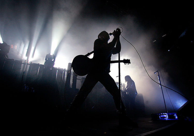 SingerTrent Reznor of Nine Inch Nails is silhouetted on stage during the KROQ Acoustic Christmas concert, Saturday night at the Gibson Amphitheatre.